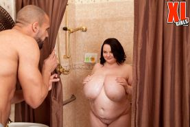 Chubby teen with huge boobs fucked hard in the shower