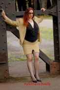 Redhead lady Justine in stockings spreading outdoors