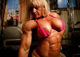 Truly massive and ultra ripped female muscle beast posing sexy