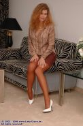 Mature redhead lady Claire undressing brown stockings
