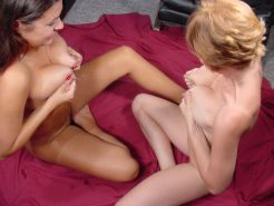 Two hot girls with milky lactating tits playing