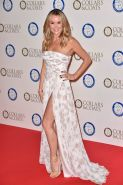 Amanda Holden busty and leggy in white strapless high slit dress at Battersea Do