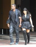 Kim Kardashian cleavy and leggy in black mini dress at Kung Pao Bistro in West H