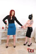 Paige Delight redhead mistress spanks ass from latex sub Angel