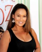 Busty Tia Carrere wearing a tight black dress at 'The Wizard Of Oz 3D' premiere