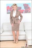 Business suit and seamed stockings glamorous mature office boss