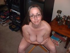 Chubby amateur girl posing and showing her big tits