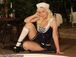 Petite blonde like a sexy sailor swimming and posing