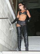 Stella Van Gent in very high boots and fishnet pantyhose