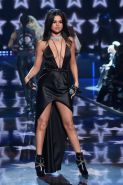 Selena Gomez showing pokies and cleavage on stage