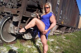 Massive blonde female bodybuilder posing sexy