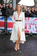 Amanda Holden leggy and cleavy wearing a white coat at Britains Got Talent Audit