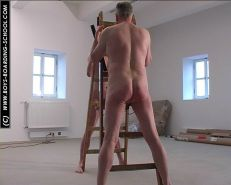 Two nude males holding stairs getting spanked by clothed FemDom