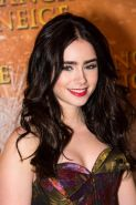 Lily Collins braless in the strapless dres at Mirror Mirror premiere in Paris