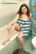 Beautiful chubby teen taking a shower