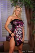 Amber Lynn Bach takes off her dress and panties and gets her toy out