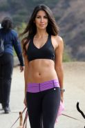 Leilani Dowding showing her fit body in sport bra and tights while hiking up Run