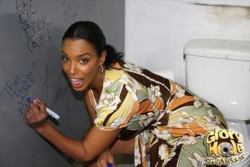 Busty black MILF sucking off a white cock at a public toilet