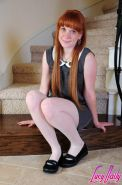 Pale redhead girl shows tits