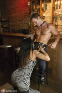 Ts Foxxy in hot dress is fucking the bartender in his ass and mouth
