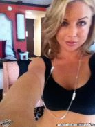 Kayden Kross playing with her phone camera at home