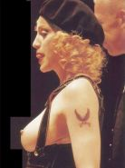 Madonna exposing her nice boobs in public and posing in panties