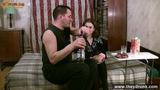Drunk beautifuleyed teen brunette Ida drinks vermouth with the g