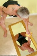 Upskirt Granny Loses Her Panties Standing Over a Mirror