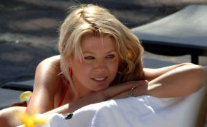 Tara Reid in red bikini and nipple slip paparazzi pictures