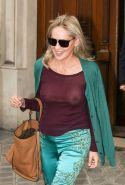 Sharon Stone showing off her huge boobs in a purple see-through top out in Paris