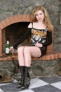Olya toys her thick hairy pussy with a beer bottle