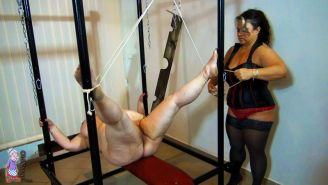 Fat older woman getting her pussy clamped in bdsm session