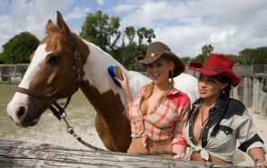 Two sexy cowgirls fuck the ranch hand