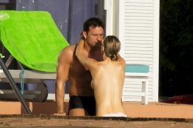 Joanna Krupa caught topless at the pool in Miami