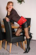 German redhead lady Claire in stockings and boots