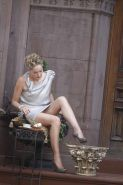 Sharon Stone showing her panties upskirt while spread cream on her legs