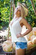 Busty blonde country girl Nikki Sims strips outdoors