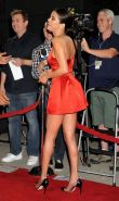 Selena Gomez braless showing big cleavage in sexy red mini dress at the Rudderle