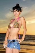 Bai Ling showing boobs in a seethru belly top and tiny leopard print bikini duri