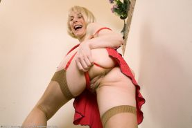 Shapely granny in stockings bares hairy pussy upskirts on stairs