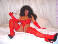 Busty Jasmine posing in red lingerie and stockings