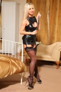 Blonde mistress in a leather dress with black stockings