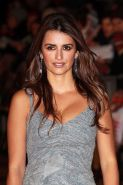 Penelope Cruz posing sexy and showing her big tits in dress