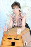 Lady sonia handcuffed in fishnets to vaulting box