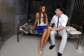 Alexis Brill brunette on heels in prison is sucking her guard for cum