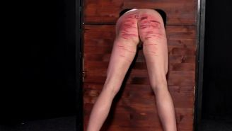 Extreme backside whipping and spanking of slaves
