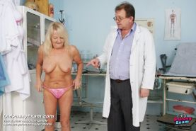 Old Dorota pussy speculum examined on gynochair at clinic