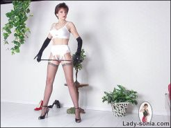Long legs lingerie and nylons dominatrix poses