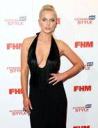 Helen Flanagan showing huge cleavage in a black low cut and high slit dress at F