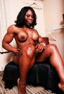 Black muscle Mistress shows off her perfectly built body